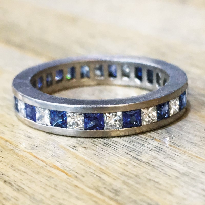 platinum diamond and sapphire princess cut channel set wedding band ring