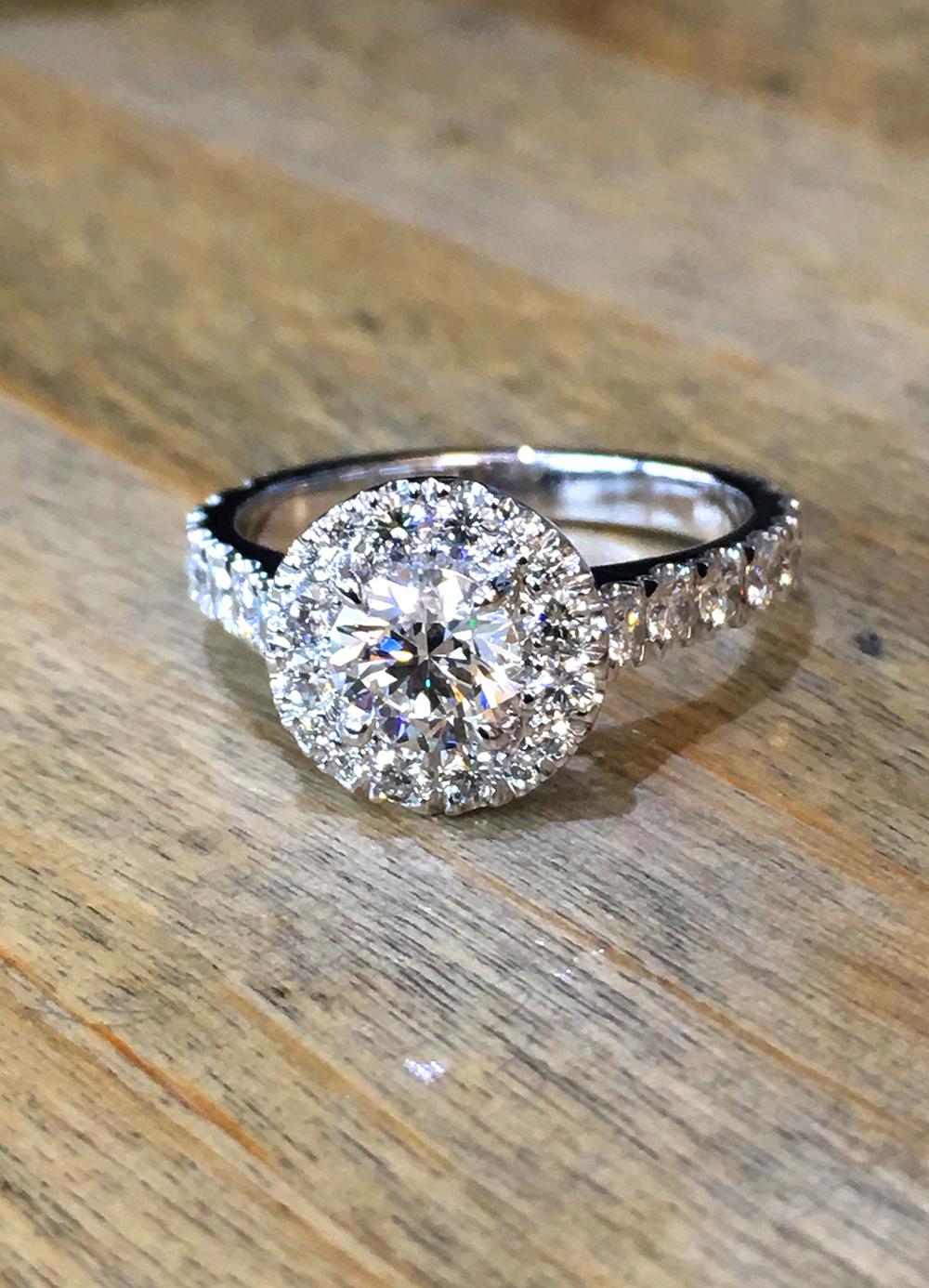 Diamond halo platinum solitaire engagement ring