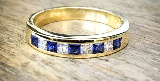 18ct yellow gold channel set ring