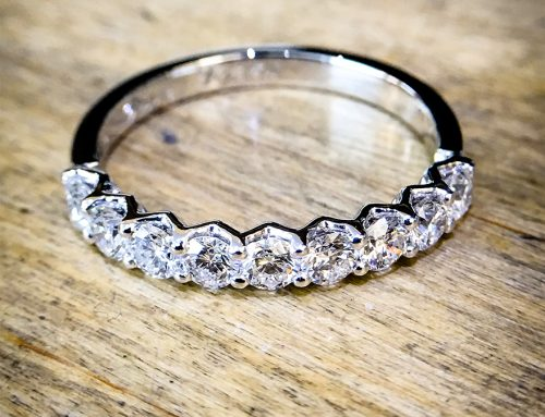 ETERNITY RINGS: Diamond & Platinum Shared Claw Half Eternity