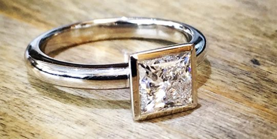 Princess cut rub over solitaire 18ct white gold engagement ring