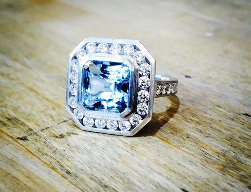 ENGAGEMENT RINGS: Diamond, Aquamarine & Platinum Halo Solitaire