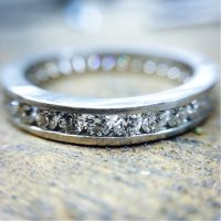 platinum and brilliant cut diamond channel set wedding band