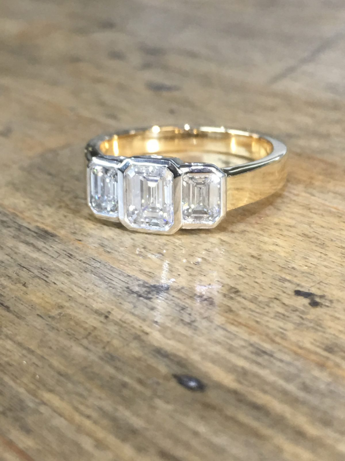 18ct platinum emerald cut diamond engagement ring